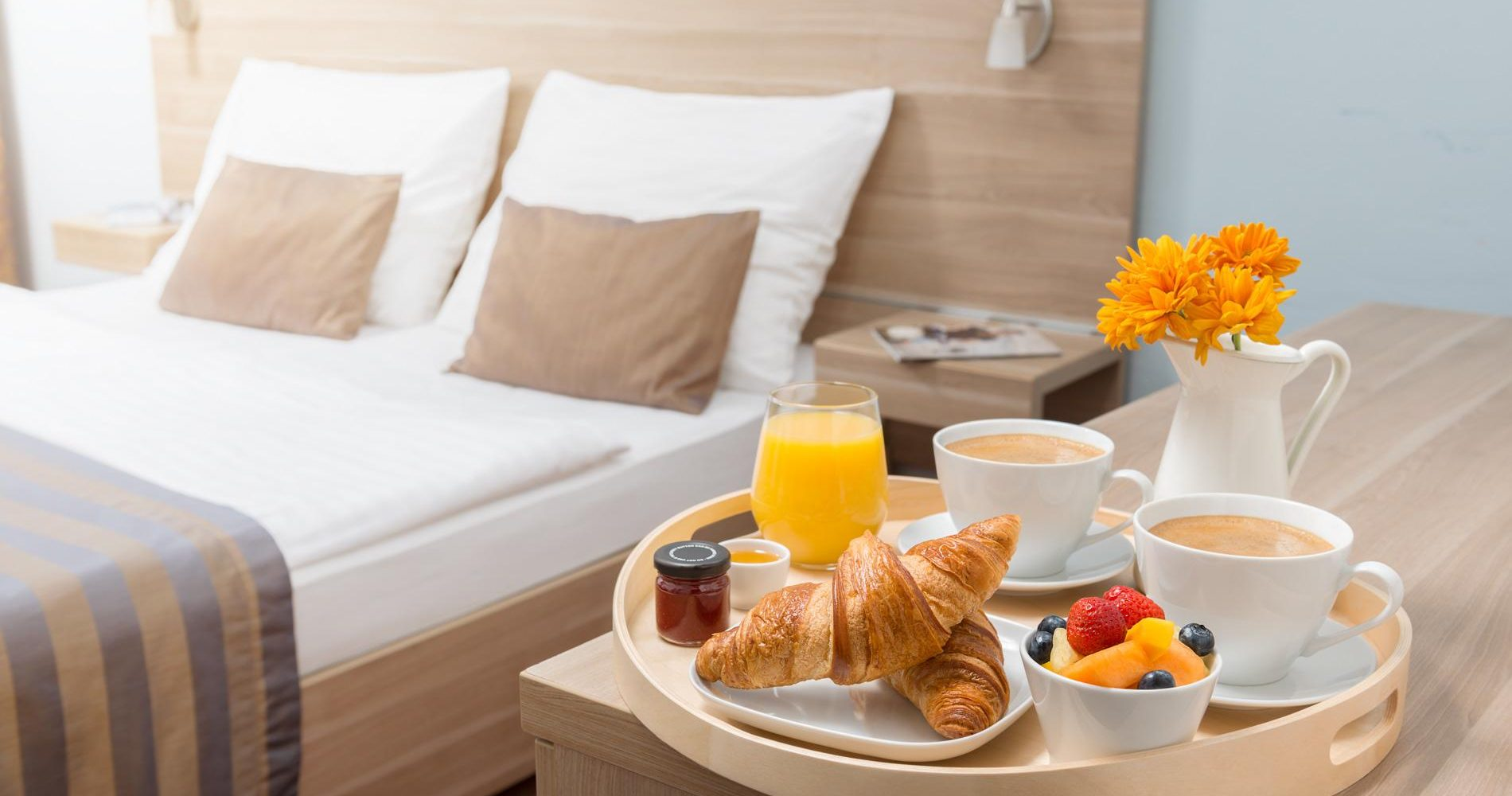 Hotel room serviced breakfast. In cozy hotel.