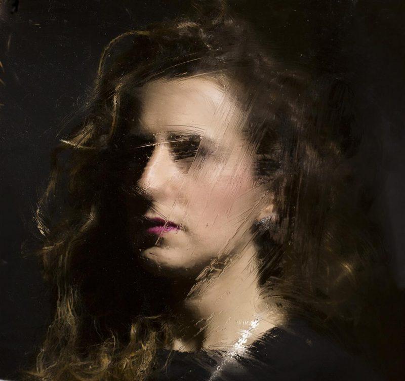 woman portrait through a glass